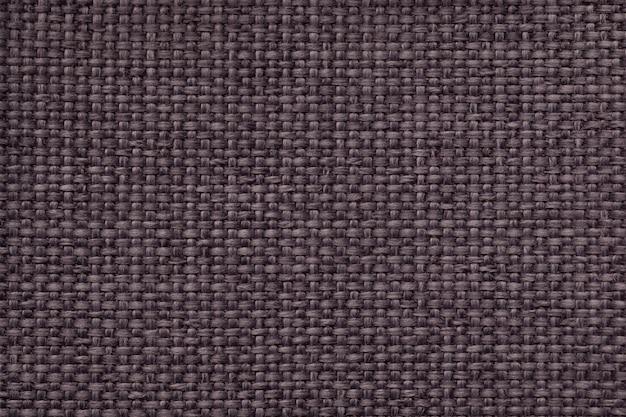 Коричневый фон с плетеной клетчатым узором, крупным планом. текстура ткацкой ткани, макро.