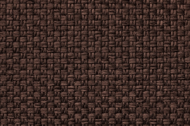 Brown background with checkered pattern, closeup. structure of the fabric macro.