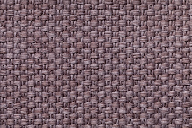 Brown background with checkered pattern structure of the fabric macro.