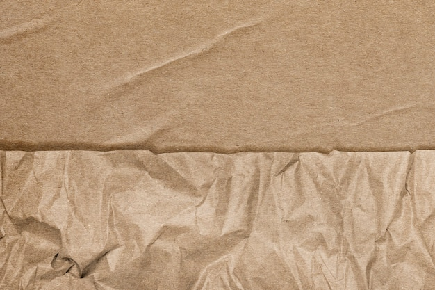 Brown background with wrinkled paper texture remixed media