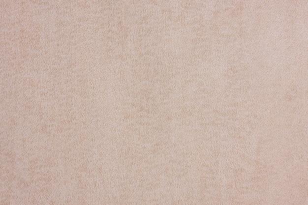 Коричневое полотенце для ванной текстильная фоновая текстура для дизайна и украшения очень крупным планом