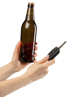 Brown beer bottle in hand isolated on white