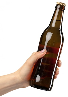 Brown beer bottle in hand isolated