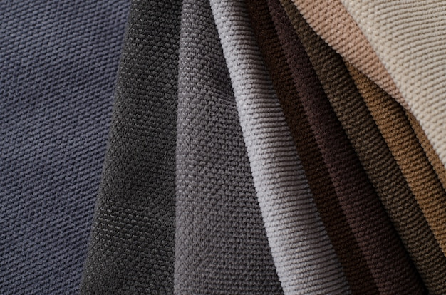 Brown, beige and grey colors velour textile samples. fabric texture