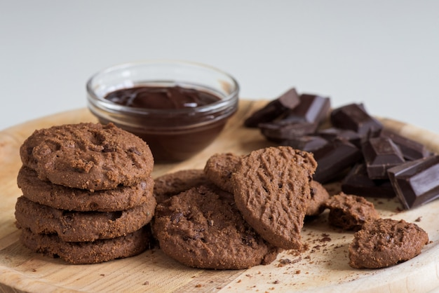 Brown biscuits with dark chocolate composition