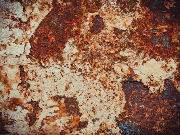 Brown, black and orange rust and dirt on white enamel