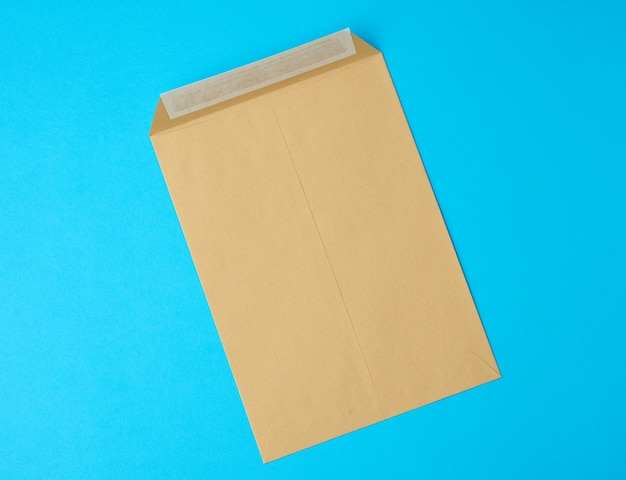 Brown blank paper envelope on a blue background