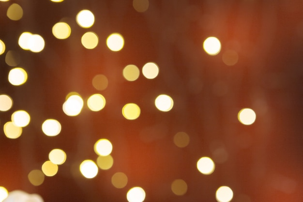 Brown blurred abstract sparkling festive bokeh background