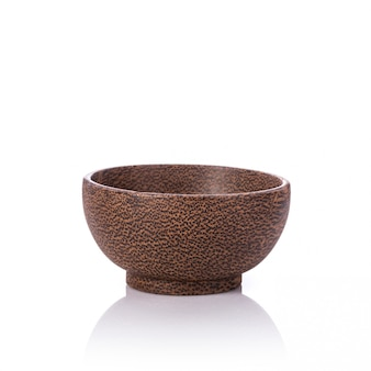 Brown bowl made from palm wood.