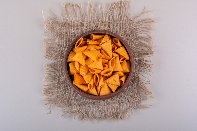 Brown bowl of triangle chips