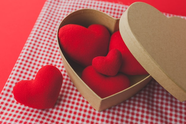 Brown box with hearts inside and a white bow