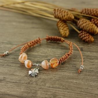 Brown bracelet on wooden background