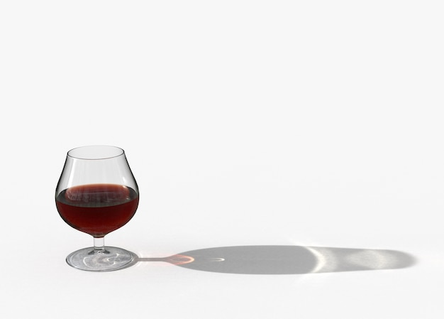 Brown brandy in the glass with long shadow on the floor copy space background