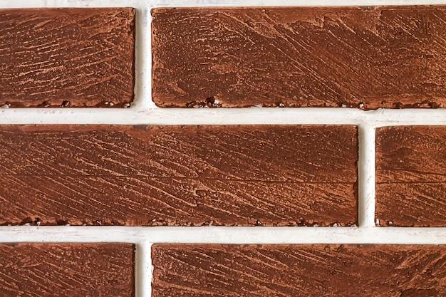 茶色のレンガの壁の背景テクスチャのクローズアップ、エクステリアまたはインテリアデザイン