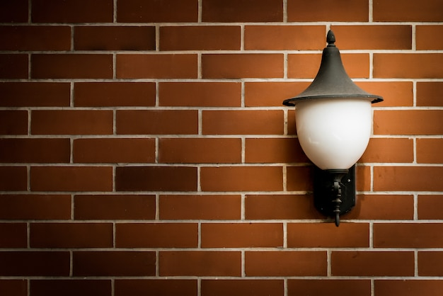 Brown brick wall and old lamp. with vintage filter