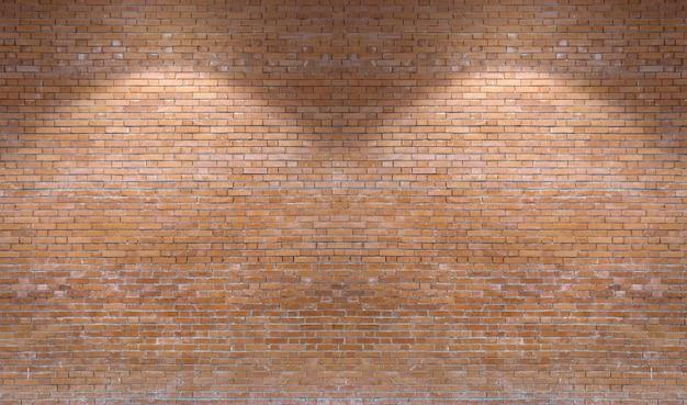 ダウンライトと茶色のレンガの壁のパターンの背景。