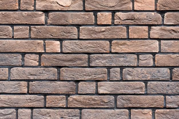 茶色のレンガの壁のテクスチャ。汚れたレンガの壁。エクステリアまたはロフトスタイルのレンガのテクスチャの背景。