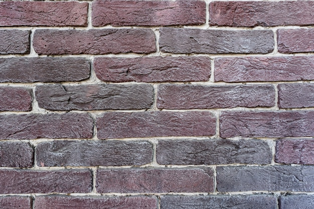 Brown brick wall. texture of old dark brown and red brick with white filling