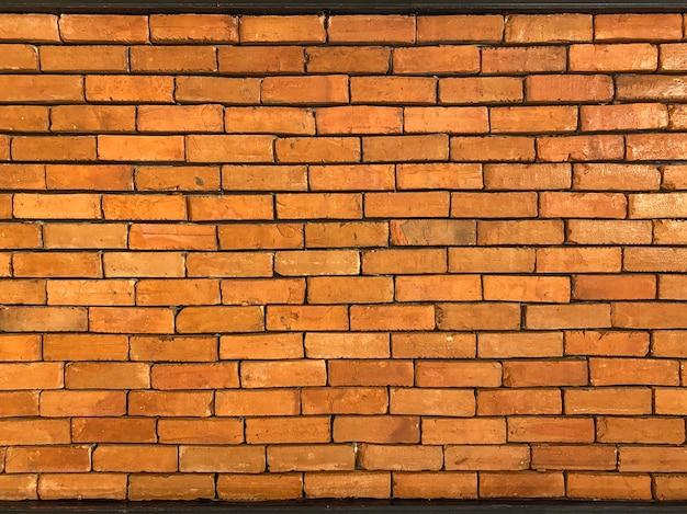 茶色のレンガの壁のテクスチャ背景。