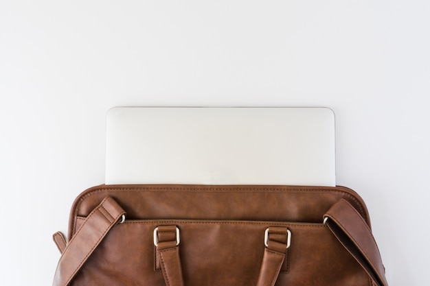 Brown briefcase with tablet