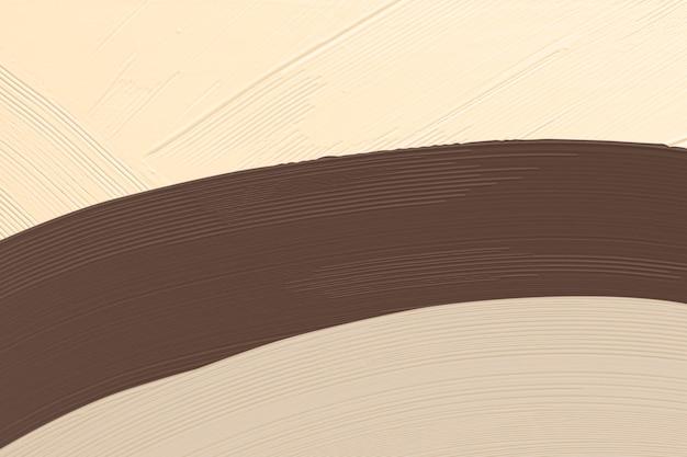 Tratto di pennello marrone strutturato sul beige