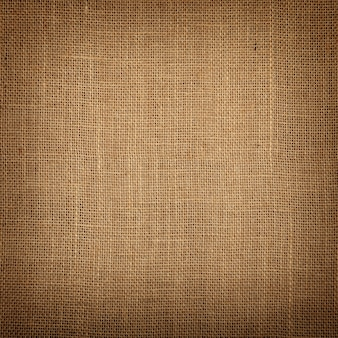 Brown burlap jute canvas background with shade