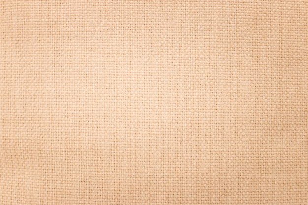 Brown burlap texture background. weave textile material or blank cloth.