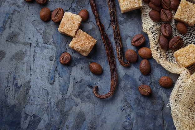 Brown cane sugar, coffee beans and  vanilla pods. selective focus