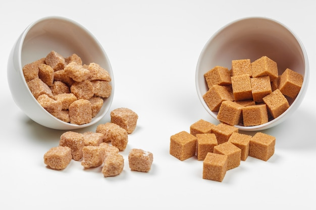 Brown cane sugar cubes isolated