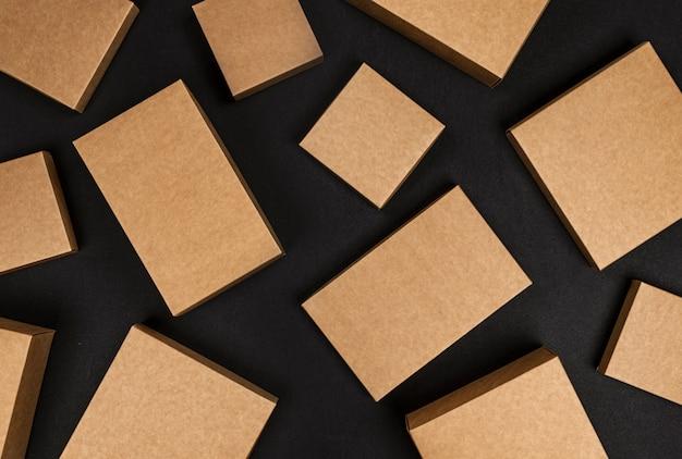 Brown cardboard boxes on black space, top view