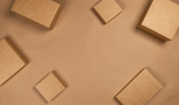 Brown cardboard boxes on craft paper space, top view