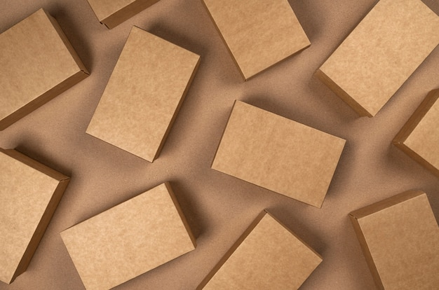 Brown cardboard boxes on craft paper , top view