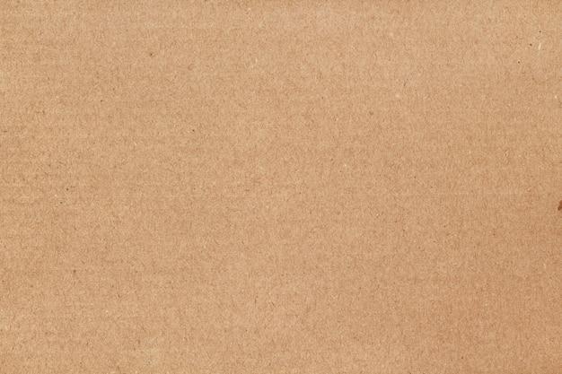 茶色の段ボールシートの抽象的な背景、デザインアート作品の古いビンテージパターンでリサイクル紙箱のテクスチャ。