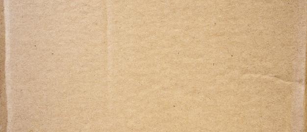 茶色の段ボールシートの抽象的な背景。リサイクル紙箱のテクスチャ。
