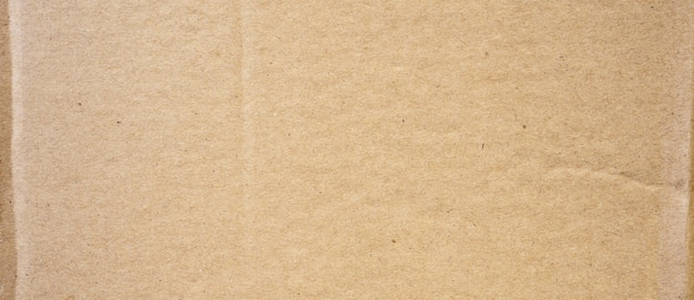Brown cardboard sheet abstract background. texture of recycle paper box.