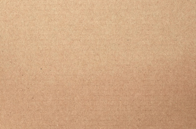 Коричневый картонный лист, текстура переработанной бумажной коробки.
