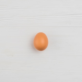 Brown chicken egg on table