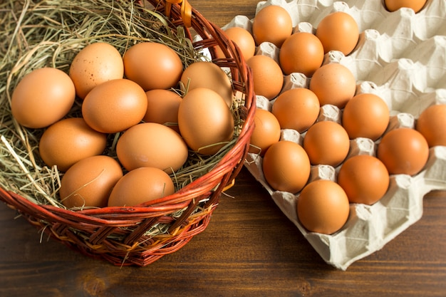 Brown chicken eggs in a basket and tray storage