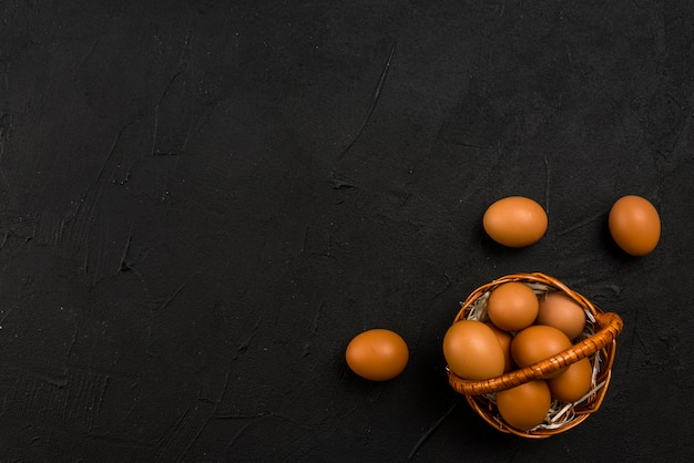 Brown chicken eggs in basket