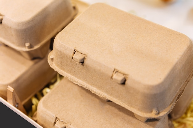Brown chicken eggs in a brown carton box.