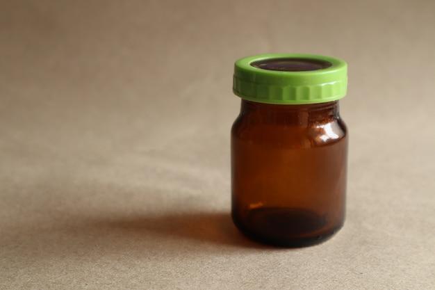Brown chicken soup drink bottle, green lid on brown