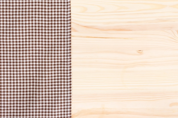 Brown cloth textile on wood background
