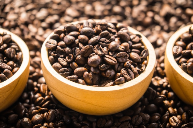 Brown coffee beans in wood bowl