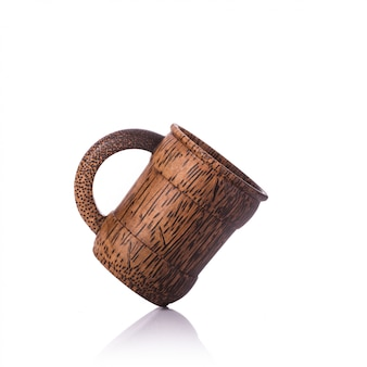 Brown coffee cup made from palm wood.