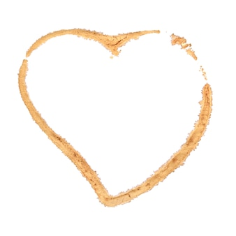 Brown coffee cup stain heart shape isolated on white background.