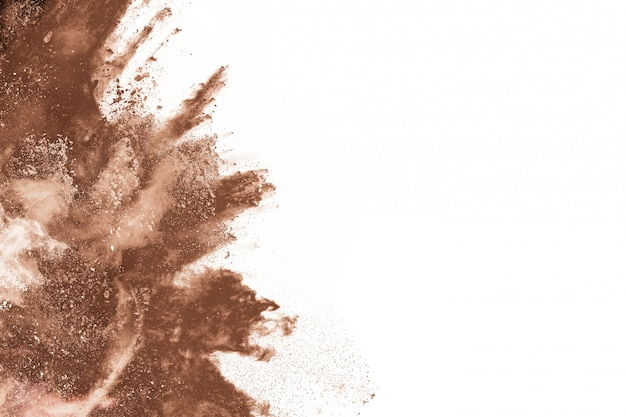 Brown color powder explosion on white background.