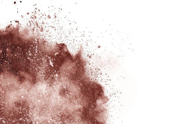 Brown color powder explosion on white background