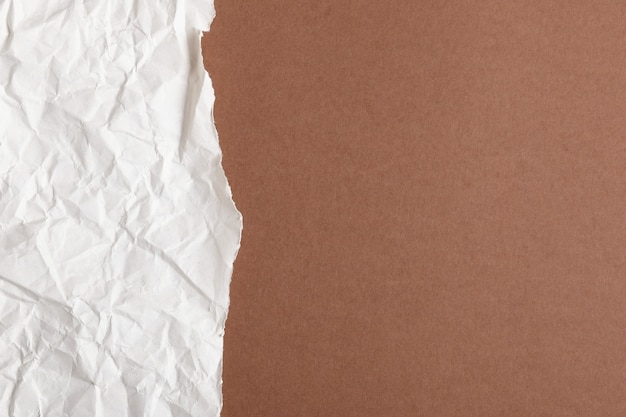 Brown colored torn paper.