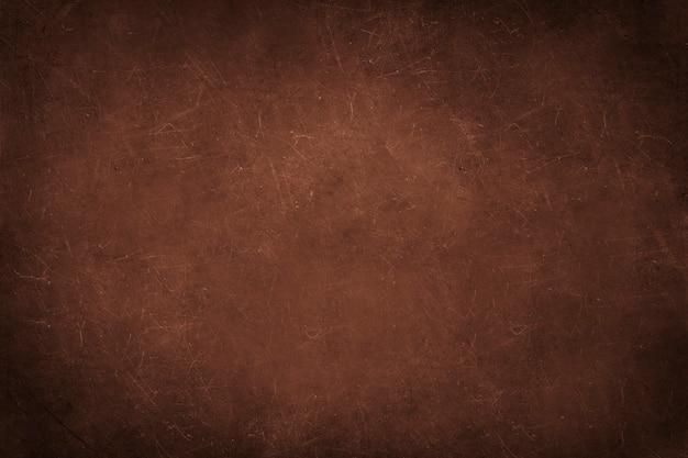 Muro di cemento marrone con graffi vettore