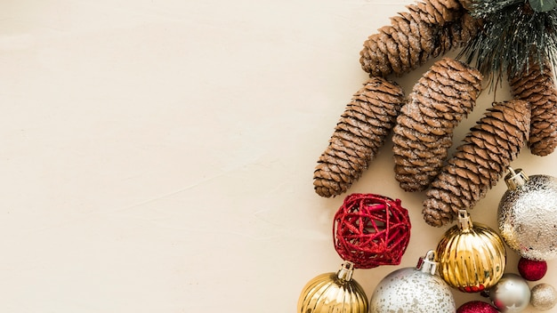 Brown cones with shiny baubles